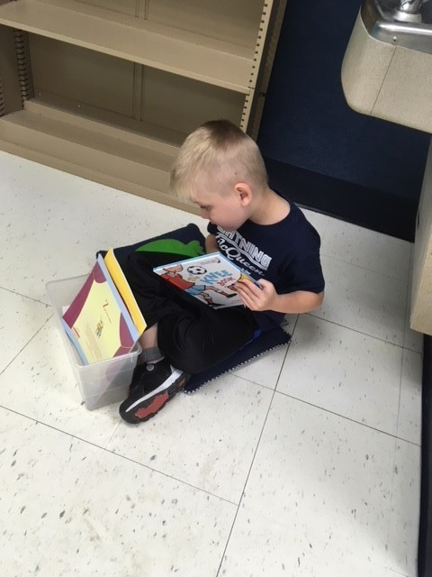 Practicing reading pictures, reading words, and retelling stories!