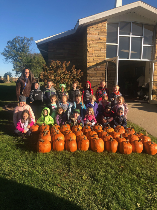 Mrs. Foster and her favorite pumpkins! 🎃