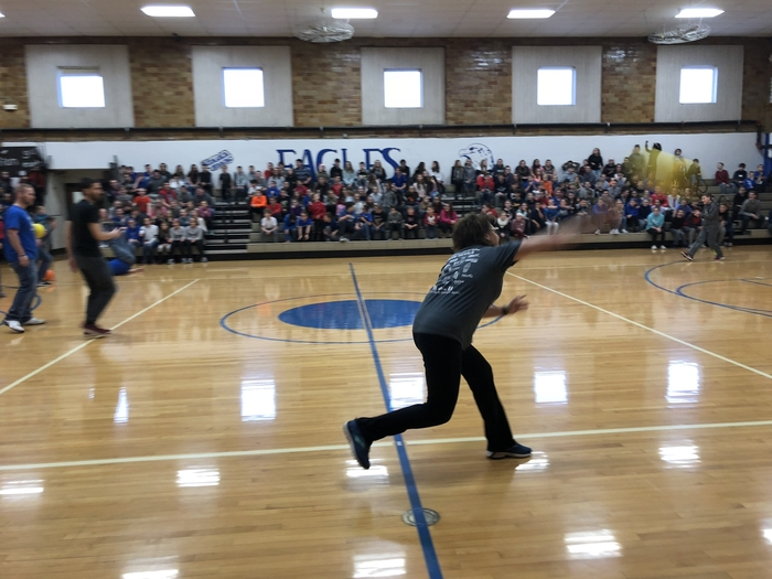 Mrs. Busick playing dodgeball against the students.