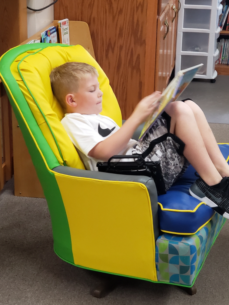 Drew reading in our fun new chair.